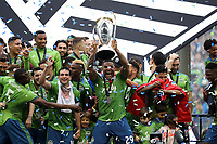 SEATTLE, WA - NOVEMBER 10: Roman Torres #29 of the Seattle Sounders FC raises the Philip F. Anschutz trophy while celebrating with his teammates during a game between Toronto FC and Seattle Sounders FC at CenturyLink Field on November 10, 2019 in Seattle, Washington.