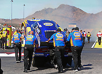 Mar 28, 2014; Las Vegas, NV, USA; Crew members push NHRA funny car driver Ron Capps into position in the water box during qualifying for the Summitracing.com Nationals at The Strip at Las Vegas Motor Speedway. Mandatory Credit: Mark J. Rebilas-