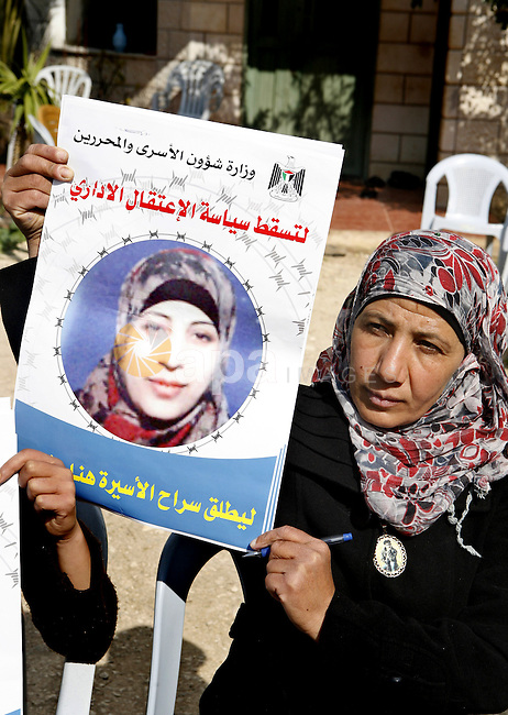Relatives of Palestinian detainee, Hana Shalabi, holds placards depicting Shalabi, in the West Bank village of Birqin, near Jenin February 27, 2012. Shalabi, released by Israel in a prisoner swap last year but re-arrested earlier this month and held without charge, is on a hunger strike to protest at her treatment, officials said on Monday. Photo by Wagdi Eshtayah