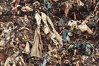 Nigeria. Enugu State. Enugu. Plastic and rubbish on  garbage heap.The open air and uncontrolled rubbish dump shows the failure in the solid-waste management. Enugu is the capital of Enugu State, located in southeastern Nigeria.  2.07.19 © 2019 Didier Ruef