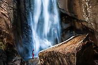 Hiker admiring Cascade de Piscia di Gallo, Piscia di Ghjaddu or Chicken Piss, waterfall, 70 m, Alta Rocca, Corsica, France