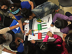The all girl team from Eliot ES is coding the perfect obstacle course.