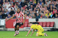 Bryan Mbeumo of Brentford in possession as Liverpool's Diago Jota looks on during Brentford vs Liverpool, Premier League Football at the Brentford Community Stadium on 25th September 2021