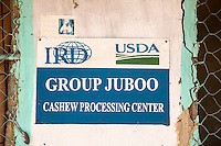 Cashew Nuts.  Sign on Wall Identifying Group Juboo Cashew Processing Center, Fass Njaga Choi, North Bank Region, The Gambia