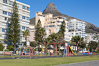 South Africa, Cape Town.  Children's Playground on the  Sea Point Promenade.  Lion's Head in the background.