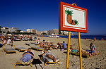 Palma Nova Majorca Spain. Winter holiday Spanish sun for English old age pensioners. Sign to show where you are positioned on beach 1980s