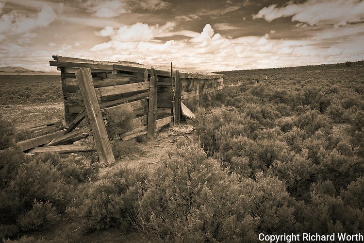 Tone black and white back-view of a shed built with railroad ties at the deserted former railroad town, now ghost town, Cobre, Nevada.