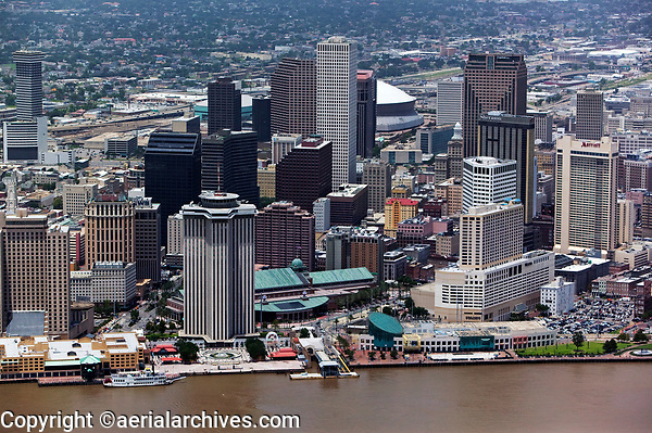 aerial photograph of the New Orleans, s, Louisiana skyline; the Canal Street Terminal, the Audubon Aquarium of the Americas and Harrah's Casino New Orleans and Harrah's Hotel, New Orleans in the foreground center. A portion of the Superdome is visible behind the skyscrapers in the background.
