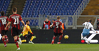 Calcio, Serie A: Lazio vs Milan. Roma, stadio Olimpico, 24 gennaio 2015.<br /> Lazio's Miroslav Klose, right, kicks to score during the Italian Serie A football match between Lazio and AC Milan at Rome's Olympic stadium, 24 January 2015.<br /> UPDATE IMAGES PRESS/Riccardo De Luca