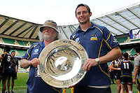 Laurie Fisher (left) and Stephen Larkham lift the trophy as they celebrate winning the World Club 7s Cup at Twickenham on Sunday 18th August 2013 (Photo by Rob Munro)