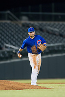 AZL Cubs third baseman Cam Balego (82) underhands the ball to the pitcher during a game against the AZL Athletics on August 9, 2017 at Sloan Park in Mesa, Arizona. AZL Athletics defeated the AZL Cubs 7-2. (Zachary Lucy/Four Seam Images)