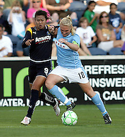 Chicago Red Stars midfielder Frida Ostberg (18) wins the ball from LA Sol forward Han Duan (9).  The Chicago Red Stars defeated the LA Sol 3-1 at Toyota Park in Bridgeview, IL on August 2, 2009.