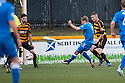 Queen of the South's Gavin Reilly (9) scores their third goal.