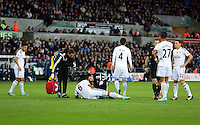 Sunday 09 November 2014 <br /> Pictured: Ashley Williams of Swansea injured on the ground<br /> Re: Barclays Premier League, Swansea City FC v Arsenal City at the Liberty Stadium, Swansea, Great Britain.