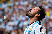Ezequiel Lavezzi of Argentina gargles with water