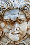 An ancient Roman face carved in marble in Leptis Magna in Libya.