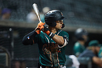 Nick Gonzales (2) of the Greensboro Grasshoppers waits for his turn to bat during the game against the Winston-Salem Dash at Truist Stadium on August 11, 2021 in Winston-Salem, North Carolina. (Brian Westerholt/Four Seam Images)