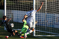 RICHMOND, VA - SEPTEMBER 30: Manny Perez #2 of North Carolina FC scores a goal past Luca Lewis #50 and John Tolkin #47 of New York Red Bulls II during a game between North Carolina FC and New York Red Bulls II at City Stadium on September 30, 2020 in Richmond, Virginia.