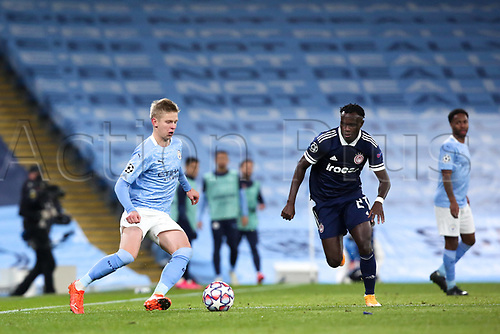 3rd November 2020; City of Manchester Stadium, Manchester, England. UEFA Champions League group stages, Manchester City versus Olympiacos;  Oleksandr Zinchenko Manchester plays the ball past Bruma (OL)
