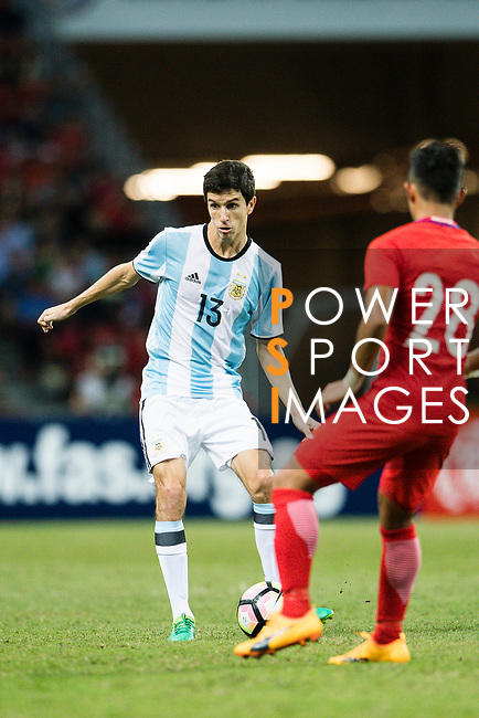 Ignacio Fernandez of Argentina (L) in action during the International Test match between Argentina and Singapore at National Stadium on June 13, 2017 in Singapore. Photo by Marcio Rodrigo Machado / Power Sport Images