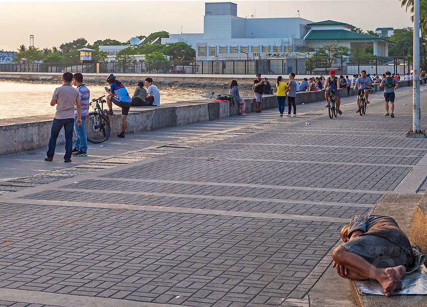 Manila, Philippines all walks of life. Street Photography Sunset time at the Manila Bay walk, Philippines