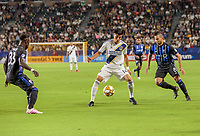 CARSON, CA - SEPTEMBER 21: Joe Corona #14 of the Los Angeles Galaxy traps a ball during a game between Montreal Impact and Los Angeles Galaxy at Dignity Health Sports Park on September 21, 2019 in Carson, California.