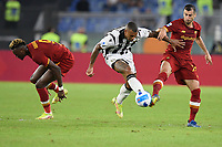 23rd September 2021;  Stadio Olimpicom, Roma, Italy; Serie A League Football, Roma versus Udinese; Rodrigo Becao of Udinese shoots between Henrikh Mkhitaryan of As Roma
