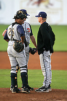 August 31, 2009:  Catcher Miguel Mendez, Pitcher Phillip Irwin, and Pitching Coach Mike Steele of the State College Spikes during a game at Frontier Field in Rochester, NY.  State College is the NY-Penn League affiliate of the Pittsburgh Pirates.  Photo By Mike Janes/Four Seam Images