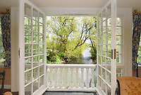 BNPS.co.uk (01202 558833)<br /> Pic:  Riverhomes/BNPS<br /> <br /> Pictured: A view of the River Thames from inside the property.<br /> <br /> A striking Victorian boathouse that has been used as a film set is on the market for £2m.<br /> <br /> The time capsule building by the River Thames was used in a film version of The Wind in the Willows and the 1996 film True Blue, about the Oxford Cambridge boat race.<br /> <br /> It has an enclosed mooring as well as two moorings on the bank, perfect for those who want to spend their days messing about in boats like Ratty and Mole.