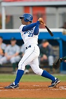 Julio Aparicio (23) of the Burlington Royals follows through on his swing at Burlington Athletic Park in Burlington, NC, Wednesday, August 13, 2008. (Photo by Brian Westerholt / Four Seam Images)