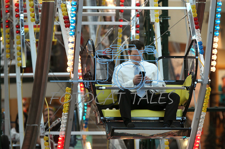 An unidentified man works the phone during the Scheels Ferris Wheel Dollar Challenge, a fundraiser for the Northern Nevada Children's Cancer Foundation on Friday, Feb. 1, 2013, at Scheels in Sparks, Nev..Photo by Cathleen Allison