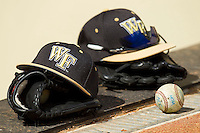 Wake Forest Demon Deacons caps sit on the top step of the visitor dugout at Alex Box Stadium on February 20, 2011 in Baton Rouge, Louisiana.  The Tigers defeated the Demon Deacons 9-1.  Photo by Brian Westerholt / Four Seam Images