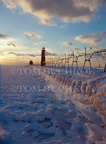 Winter sunset at Grand Haven South Pier Lighthouse, South Haven, Michigan on Lake Michigan.