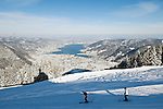 Germany, Bavaria, Upper Bavaria, Tegernseer Valley, Winter at Wallberg mountain, view across Lake Tegern; skiers going downhill