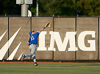 Jesuit Tigers outfielder Wes Mendes (11) attempts to catch a fly ball during a game against the IMG Academy Ascenders on April 21, 2021 at IMG Academy in Bradenton, Florida.  (Mike Janes/Four Seam Images)