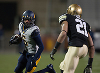 Chris Harper of California runs the ball during the game against Colorado at Folsom Field in Boulder, Colorado on November 16th, 2013.  Colorado defeated California, 41-24.
