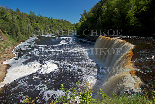Upper Tahquamenon Falls in the Upper Peninsula of Michigan, is one of the largest falls east of the Mississippi. It drops fifty feet and is 200 ft wide. Located in Luce county north of Newberry.