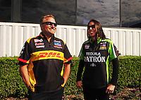 Nov. 13, 2011; Pomona, CA, USA; NHRA funny car driver Jeff Arend (left) with Alexis DeJoria during the Auto Club Finals at Auto Club Raceway at Pomona. Mandatory Credit: Mark J. Rebilas-.