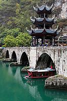Zhenyuan, Guizhou, China.  River Cruise Boat Passing under the Zhusheng Bridge across the Wuyang River.