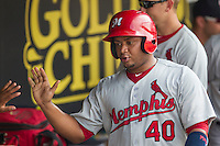 Memphis Redbirds catcher Audry Perez (40) in the dugout after scoring during the first game of a Pacific Coast League doubleheader against the Round Rock Express on August 3, 2014 at the Dell Diamond in Round Rock, Texas. The Redbirds defeated the Express 4-0. (Andrew Woolley/Four Seam Images)