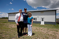 Brandon Nimmo, center, poses for a portrait with his parents, Ron and Patti Nimmo, outside the family's 2688 sq. ft. barn on Tuesday, June 21, 2011, in Cheyenne, Wyo. The barn houses a batting cage where Nimmo was able to perfect his left-handed swing growing up. The New York Mets selected Nimmo, who graduated from high school in May, at No. 13 overall in this year's MLB draft. (Photo by James Brosher)