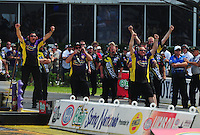May 1, 2011; Baytown, TX, USA: The crew for NHRA pro stock driver Vincent Nobile celebrate a win during the Spring Nationals at Royal Purple Raceway. Mandatory Credit: Mark J. Rebilas-