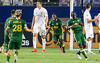CARSON, CA - OCTOBER 07: Yimmi Chara #23 of the Portland Timbers  scores a goal and celebrates with his Portland Timbers teammates during a game between Portland Timbers and Los Angeles Galaxy at Dignity Heath Sports Park on October 07, 2020 in Carson, California.