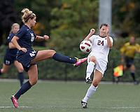 Yale University midfielder Muriel Battaglia (44) passes the ball as Harvard University forward Elizabeth Weisman (24) closes. In overtime, Harvard University defeated Yale University,1-0, at Soldiers Field Soccer Stadium, on September 29, 2012.
