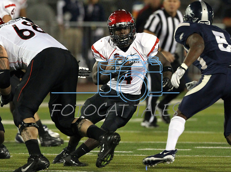 San Diego State's Adam Muema (4) runs up the middle during the first half of an NCAA college football game in Reno, Nev., on Saturday, Oct. 20, 2012. Nevada is leading San Diego State 10-6 going into the second half.(AP Photo/Cathleen Allison)