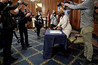 House staffer Latrice Powell places H.R. 24, an article of impeachment against President Donald Trump, on a table prior to an engrossment ceremony on Wednesday, January 13, 2021 at the U.S. Capitol.<br /> Credit: Greg Nash / Pool via CNP /MediaPunch