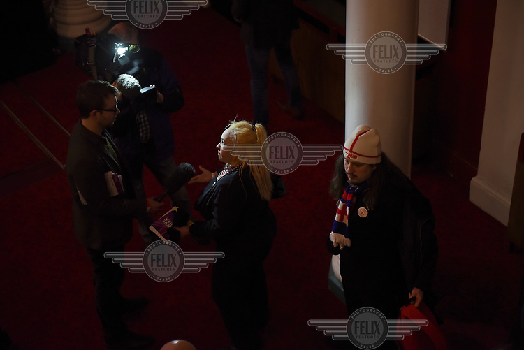A woman is interviewed by the media during the UKIP Spring Conference at the Winter Gardens theatre.
