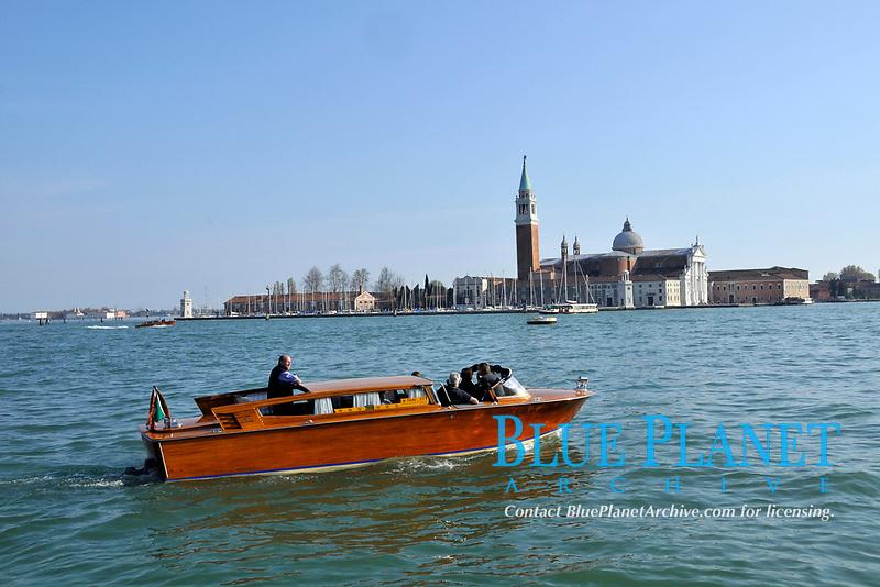 Speed boat commutes in Venetian lagoon, between Piazza San Marco and San Giorgio Maggiore Island, Venice, Veneto, Italy