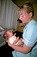 Midwife attending to new born baby. This image may only be used to portray the subject in a positive manner..©shoutpictures.com..john@shoutpictures.com