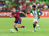 AUSTIN, TX - JUNE 16: Kelley O'Hara #5 of the United States looks to pass the ball in front of Assist Oshoala #8 of Nigeria during a game between Nigeria and USWNT at Q2 Stadium on June 16, 2021 in Austin, Texas.